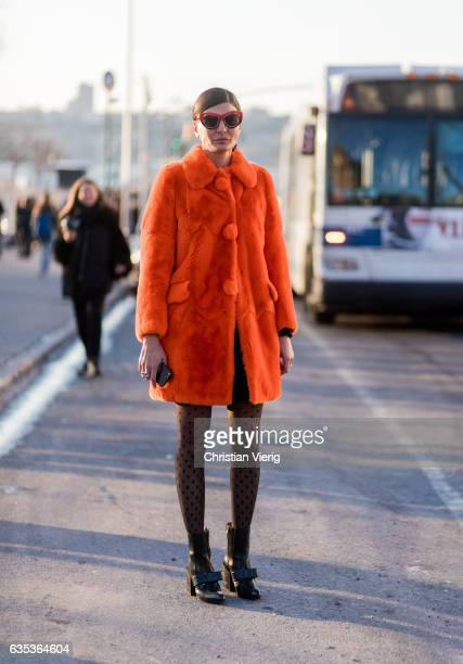 Giovanna Battaglia wearing an orange teddy coat tights outside Coach on February 14 2017 in New York City