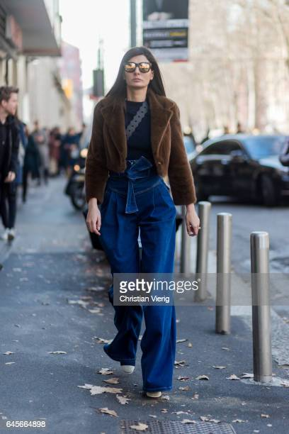 Giovanna Battaglia wearing brown fake fur jacket denim jeans outside Marni during Milan Fashion Week Fall/Winter 2017/18 on February 26 2017 in Milan...