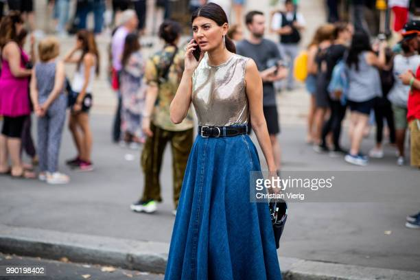Giovanna Battaglia wearing high waist denim shirt Hermes glitter top is seen outside Schiaparelli on day two during Paris Fashion Week Haute Couture...