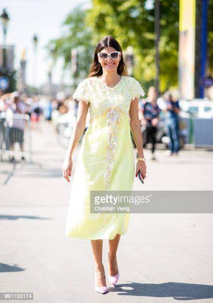 Giovanna Battaglia wearing yellow dress seen outside Chanel on day three during Paris Fashion Week Haute Couture FW18 on July 2 2018 in Paris France
