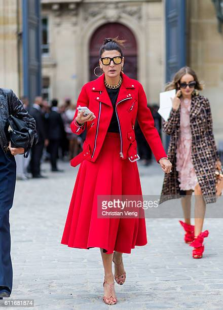 Giovanna Battaglia wears a red skirt and red jacket outside of Dior on September 30, 2016 in Paris, France.
