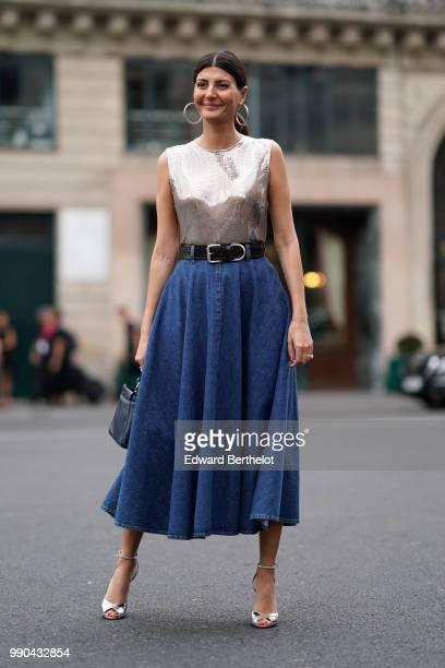 Giovanna Battaglia wears a silver sleeveless top a blue denim skirt a belt outside Schiaparelli during Paris Fashion Week Haute Couture Fall Winter...