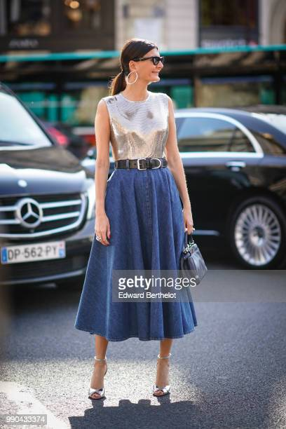 Giovanna Battaglia wears a silver sleeveless top a blue skirt outside Schiaparelli during Paris Fashion Week Haute Couture Fall Winter 2018/2019 on...