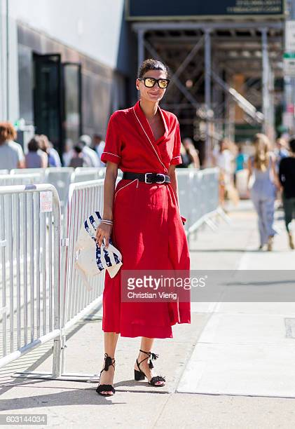 Giovanna Engelbert wearing a red dress outside J Crew on September 11 2016 in New York City