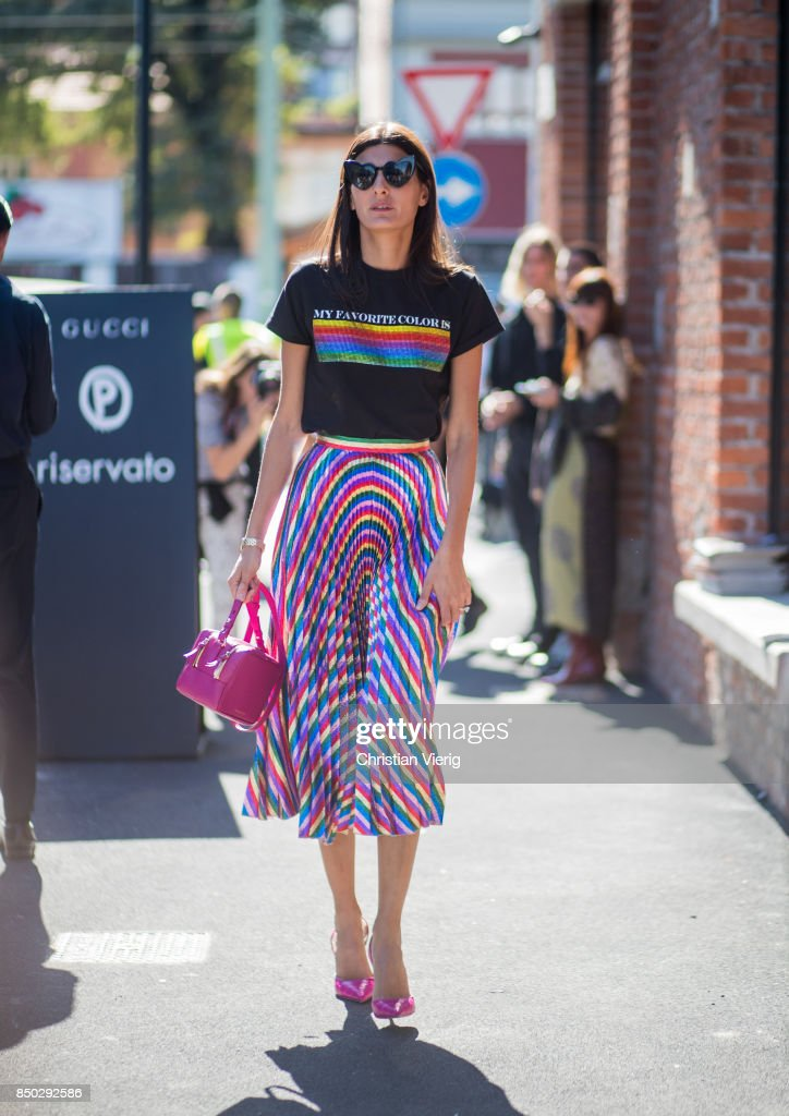 Giovanna Engelbert wearing a tshirt with the print 'my favorite colour is rainbow flag', midi skirt is seen outside Gucci during Milan Fashion Week Spring/Summer 2018 on September 20, 2017 in Milan, Italy.