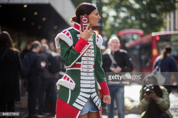 Giovanna Engelbert wearing circus jacket outside Erdem during London Fashion Week September 2017 on September 18 2017 in London England