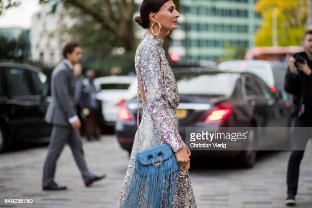 Giovanna Engelbert wearing glitter dress, JW Anderson bag with fringes outside Emilia Wickstead during London Fashion Week September 2017 on...