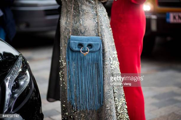 Giovanna Engelbert wearing glitter dress JW Anderson bag with fringes outside Emilia Wickstead during London Fashion Week September 2017 on September...