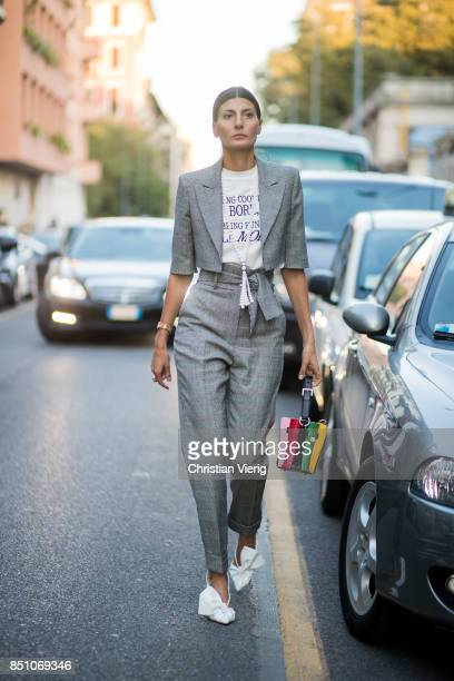 Giovanna Engelbert wearing grey checked suit, white heels is seen outside Prada during Milan Fashion Week Spring/Summer 2018 on September 21, 2017 in...