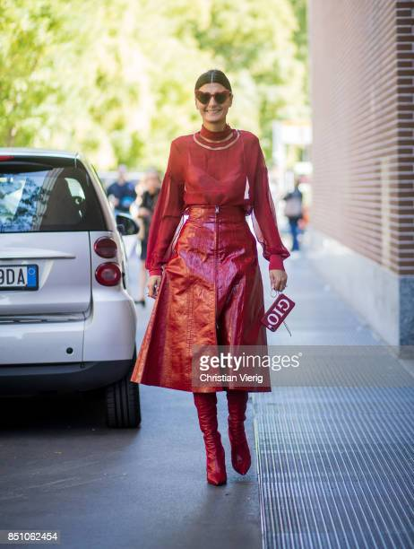 Giovanna Engelbert wearing red blouse red skirt red overknees is seen outside Fendi during Milan Fashion Week Spring/Summer 2018 on September 21 2017...