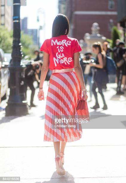 b5d9b2d4d1 Giovanna Engelbert wearing red tshirt with the print more is glamore red  white striped skirt seen