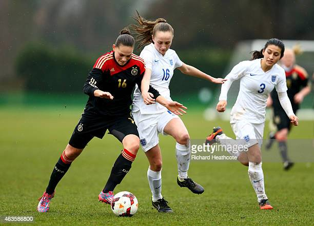 Giovanna Hoffmann of Germany holds off the challenge of Megan Finnigan of England during the U17 Girls International Friendly match between England...