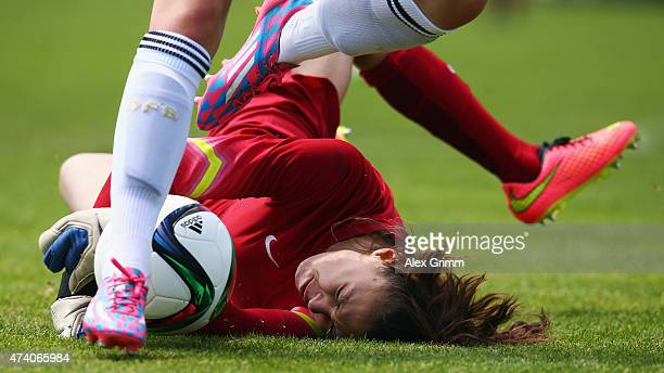 Giovanna Hoffmann of Germany is challenged by goalkeeper Constance Picaud of France during the U17 girls international friendly match between germany...