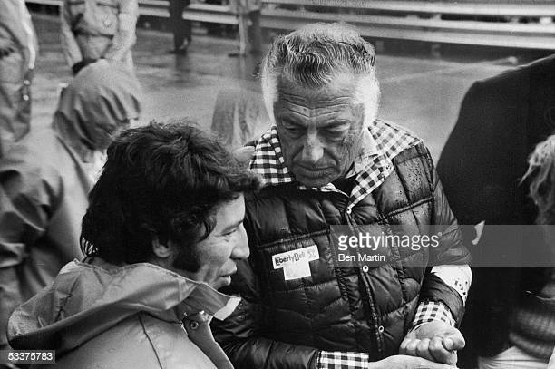 Giovanni Agnelli head of the family which owns the Fiat Group talking with race car driver Mario Andretti during a break in Grand Prix racing