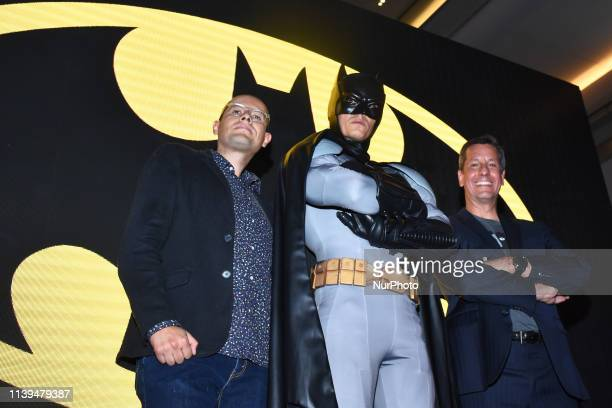 Giovanni Arevalo Batman Javier Garza poses for photos during the presentation of Batman special Edition Magazine as part of 80th anniversary of...