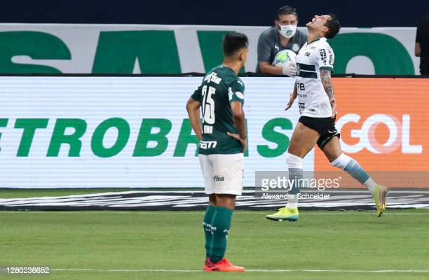 Giovanni Augusto of Coritiba celebrates after scoring the third goal of his team during the match against Palmeiras as part of Brasileirao Series A...