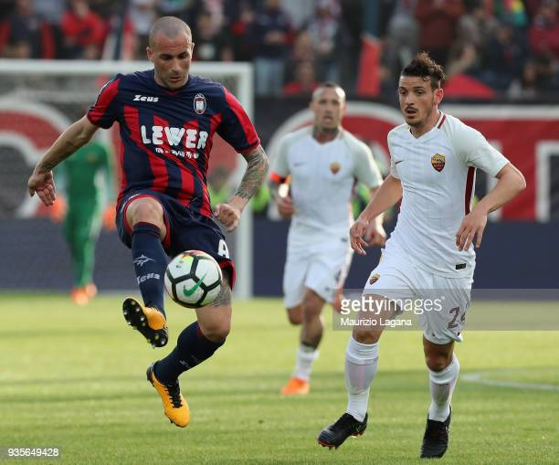 Giovanni Crociata of Crotone competes for the ball with Alessandro Florenzi of Roma during the serie A match between FC Crotone and AS Roma at Stadio...
