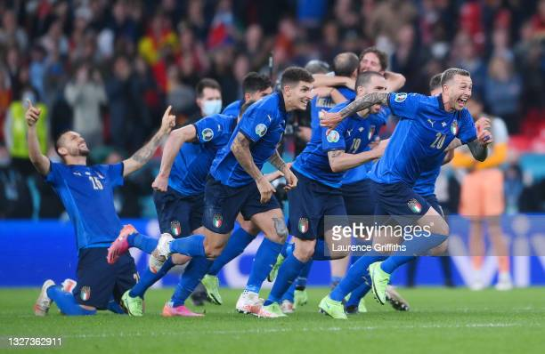 Giovanni Di Lorenzo, Leonardo Bonucci and Federico Bernardeschi of Italy celebrate following their team's victory in the penalty shoot out after the...