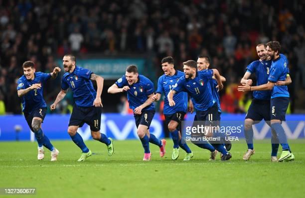 Giovanni Di Lorenzo, Leonardo Bonucci, Andrea Belotti, Matteo Pessina, Domenico Berardi, Giorgio Chiellini and Manuel Locatelli of Italy celebrate...