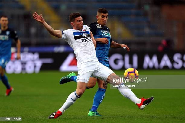 Giovanni Di Lorenzo of Empoli FC battles for the ball with Robin Godens of Atalanta BC during the Serie A match between Empoli and Atalanta BC at...