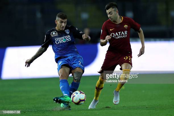 Giovanni Di Lorenzo of Empoli FC battles for the ball with Stepahn El Shaarawy of AS Roma during the Serie A match between Empoli and AS Roma at...