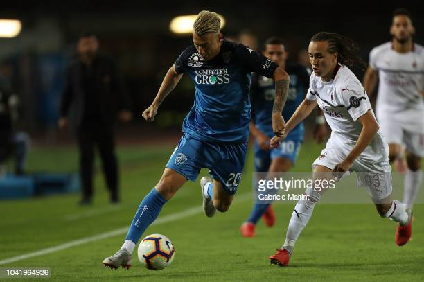 Giovanni Di Lorenzo of Empoli FC in actio against Diego Laxalt of AC Milkan during the serie A match between Empoli and AC Milan at Stadio Carlo...