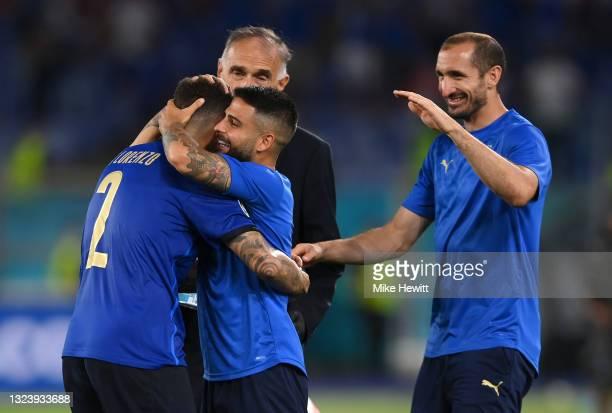 Giovanni Di Lorenzo of Italy celebrates victory with Lorenzo Insigne and Giorgio Chiellini during the UEFA Euro 2020 Championship Group A match...