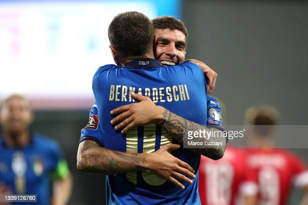 Giovanni Di Lorenzo of Italy celebrates with Federico Bernardeschi after scoring their side's fifth goal during the 2022 FIFA World Cup Qualifier...