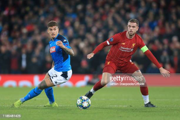 Giovanni Di Lorenzo of Napoli battles with Jordan Henderson of Liverpool during the UEFA Champions League group E match between Liverpool FC and SSC...