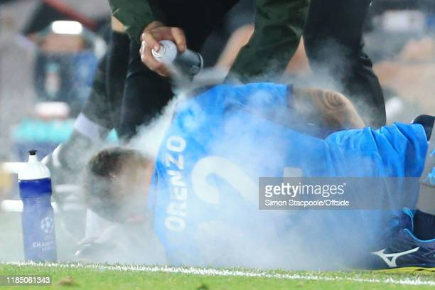 Giovanni Di Lorenzo of Napoli receives some spray treatment during the UEFA Champions League group E match between Liverpool FC and SSC Napoli at...