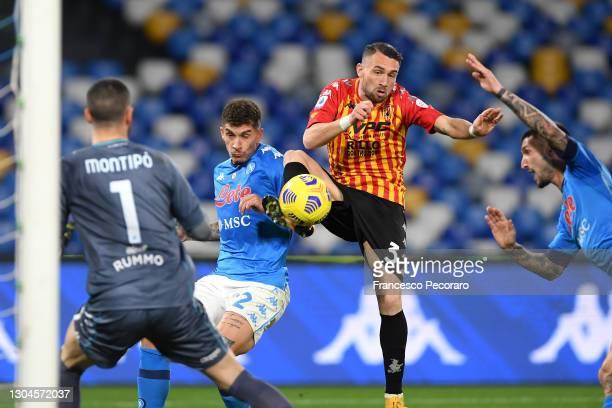 Giovanni Di Lorenzo of Napoli scores their side's second goal past Lorenzo Montipo of Benevento Calcio whilst under pressure from Gaetano Letizia of...