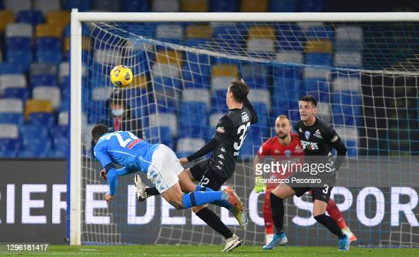 Giovanni Di Lorenzo of Napoli scores their team's first goal as Nicolas Haas of Empoli attempts to block during the Coppa Italia match between SSC...