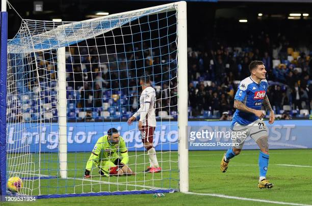 Giovanni Di Lorenzo of SSC Napoli celebrates after scoring the 2-0 goal, beside the disappointment of Salvatore Sirigu of Torino FC during the Serie...