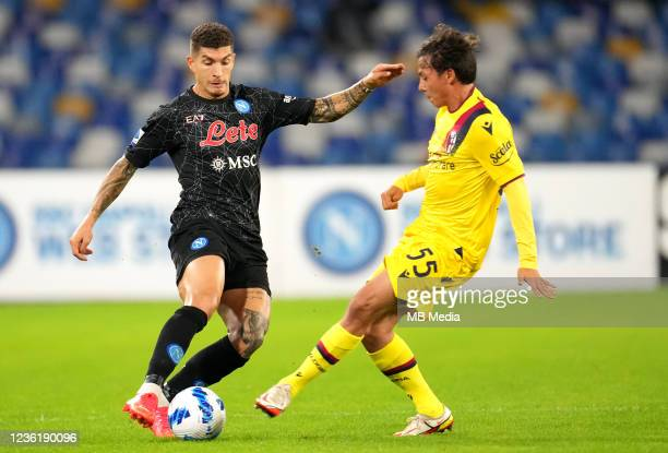 Giovanni Di Lorenzo of SSC Napoli competes for the ball with Emanuel Vignato of Bologna FC ,during the Serie A match between SSC Napoli and Bologna...