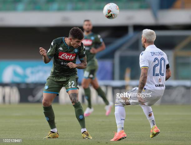 Giovanni Di Lorenzo of SSC Napoli jumps for the ball against Mattia Zaccagni of Hellas Verona during the Serie A match between Hellas Verona and SSC...