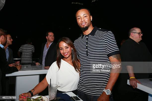 Giovanni Fortes and Rashard Lewis attends Dwyane Wade's 'Rock The Boat' 32nd Birthday Party on January 11 2014 in Miami Beach Florida