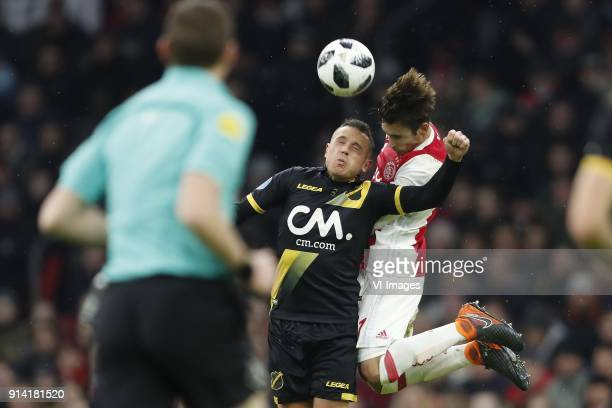 Giovanni Korte of NAC Breda Nico Tagliafico of Ajax during the Dutch Eredivisie match between Ajax Amsterdam and NAC Breda at the Amsterdam Arena on...