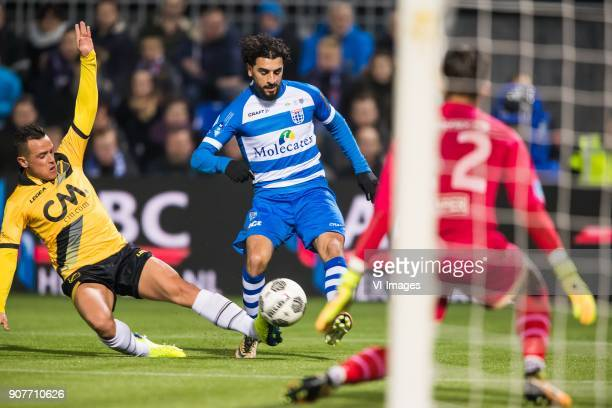 Giovanni Korte of NAC Breda Youness Mokhtar of PEC Zwolle goalkeeper Mark Birighitti of NAC Breda during the Dutch Eredivisie match between PEC...