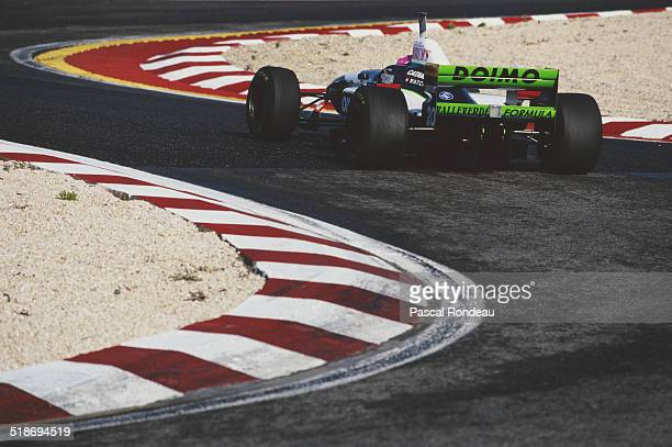Giovanni Lavaggi of Italy drives the Minardi Team Minardi M195B Ford V8 during practice for the Portuguese Grand Prix on 21st September 1996 at the...