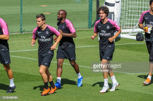 Giovanni Lo Celso Lassana Diarra of PSG and Yacine Adli of PSG during the Training Session of Paris Saint Germain at Camp des Loges on August 11 2018...