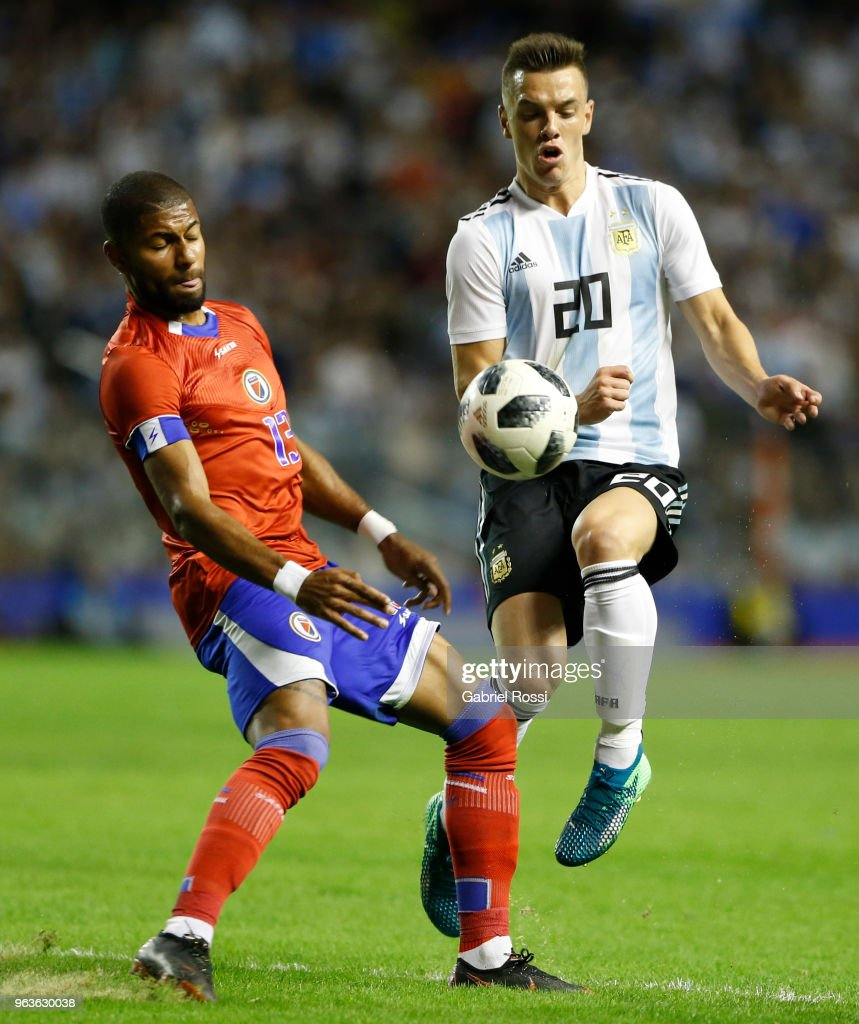 Giovanni Lo Celso of Argentina fights for the ball with Mikael Cantave of Haiti during an international friendly match between Argentina and Haiti at Alberto J. Armando Stadium on May 29, 2018 in Buenos Aires, Argentina.