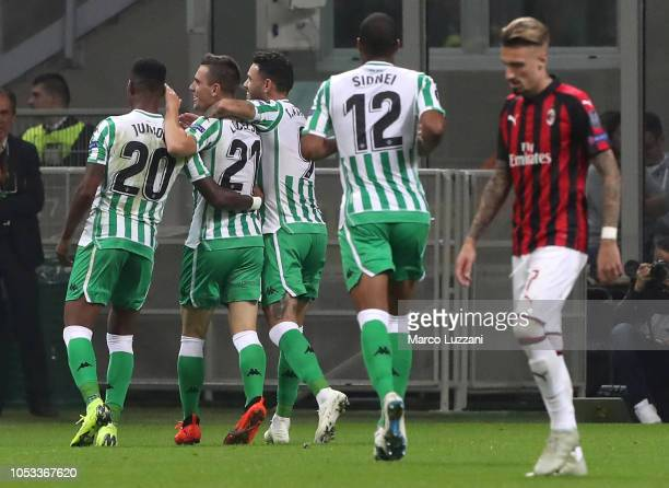 Giovanni Lo Celso of Real Betis celebrates his goal with his teammates during the UEFA Europa League Group F match between AC Milan and Real Betis at...