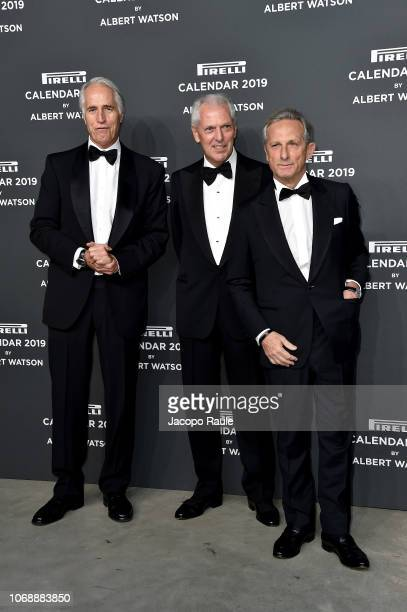 Giovanni Malago Marco Tronchetti Provera and a guest walk the red carpet ahead of the 2019 Pirelli Calendar launch gala at HangarBicocca on December...