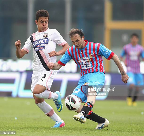 Giovanni Marchese of Catania competes for the ball with Paulo Dybala of Palermo during the Serie A match between Calcio Catania and US Citta di...