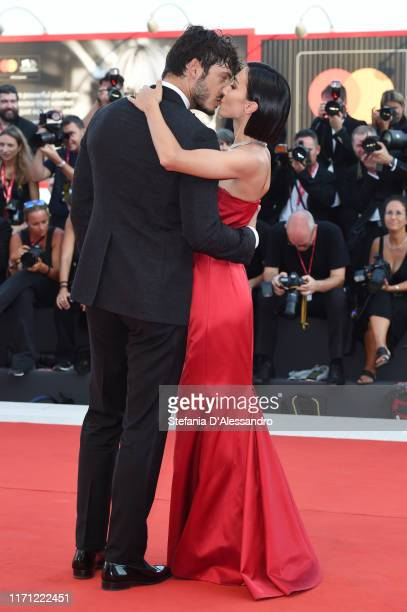 Giovanni Masiero and Francesca Rocco walk the red carpet ahead of the J'Accuse screening during the 76th Venice Film Festival at Sala Grande on...