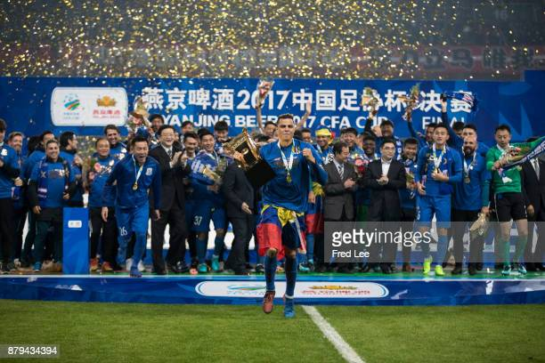 Giovanni Moreno of Shanghai Greenland Shenhua receives the 2017 CFA Cup Final Round during the award ceremony after the 2017 CFA Cup Final Round...