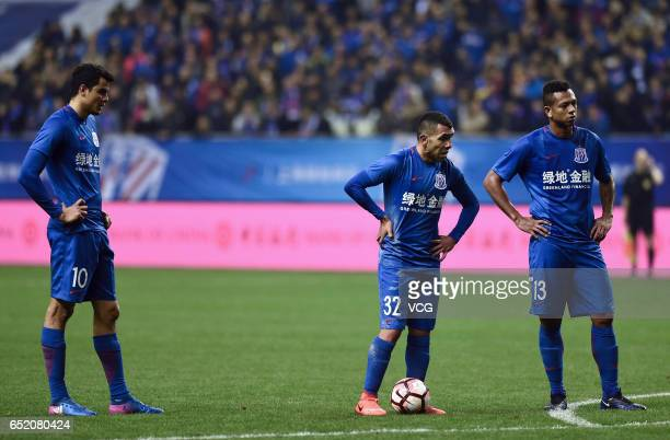 Giovanni Moreno Carlos Tevez and Fredy Guarin of Shanghai Shenhua in action during the 2nd round match of CSL Chinese Football Association between...