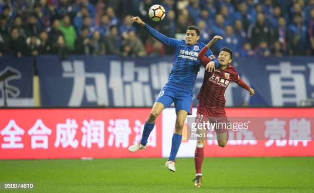 Giovanni Moreno of Shanghai Greenland Shenhua and Hai yu of Shanghai SIPG in action during the 2018 Chinese Super League match between Shanghai...