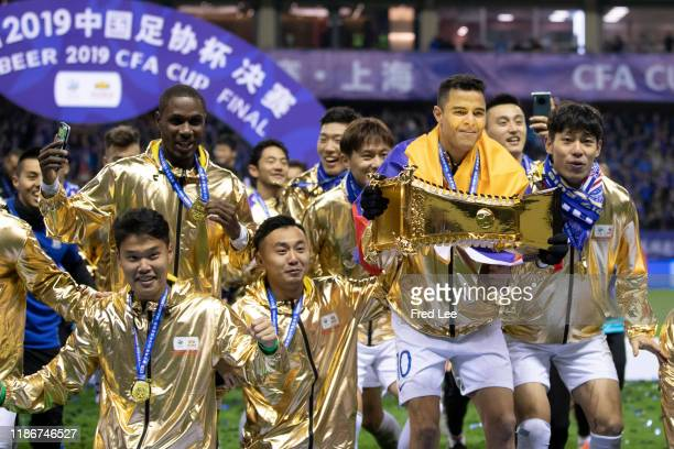 Giovanni Moreno of Shanghai Greenland Shenhua and teammates celebrate with the trophy during the award ceremony after the 2019 CFA Cup Final Shanghai...