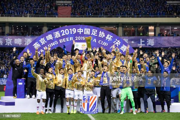 Giovanni Moreno of Shanghai Greenland Shenhua celebrates with teammates and staff winning the 2019 CFA Cup Final Round during the award ceremony...
